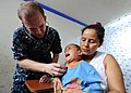 US Navy 100811-N-4153W-184 Lt. Cmdr. Brian Thomas checks the heart beat of a Colombian child at Escuela Ismael Contreras, in Covenas, Colombia.jpg