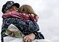 US Navy 101015-N-8467N-003 Senior Chief Fire Control Technician David Fennell hugs his three-year-old daughter during a homecoming celebration for.jpg