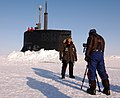 US Navy 110326-N-7058E-050 NN correspondent Kaj Larsen films a documentary segment in front of the sail of USS Connecticut (SSN 22) during Ice Exer.jpg