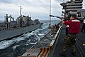 US Navy 111122-N-BT887-046 Gunner's Mate 2nd Class Phillip Grauer, from Sheridan, Ore., fires a phone and distance line to the Military Sealift Com.jpg