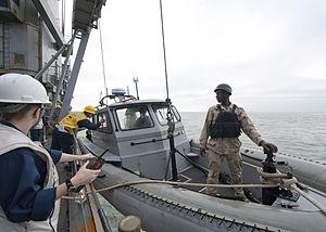 US Navy 111213-N-NR955-010 Sailors assigned to the Whidbey Island-class amphibious dock landing ship USS Gunston Hall (LSD 44) drop an 11-meter rig.jpg