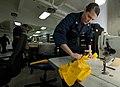 US Navy 111214-N-DR144-047 Aircrew Survival Equipmentman 3rd Class Haley Craft deflates air bladders for LPU-34B-P low-profile floatation collars i.jpg