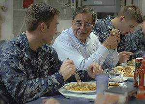 US Navy 120121-N-NC372-529 Secretary of Defense Leon E. Panetta speaks with Damage Controlman 2nd Class Benjamin Clark during lunch.jpg