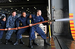 US Navy 120122-N-UM734-210 Sailors from the amphibious assault ship USS Kearsarge (LHD 3) practice fire fighting hose-handling procedures as part o.jpg