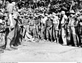 US and Australian soldiers with Japanese prisoner 057472.JPG