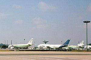 Union de Transports Aériens - A UTA Boeing 747 next to Air Afrique planes at Paris-Charles de Gaulle in 1991.