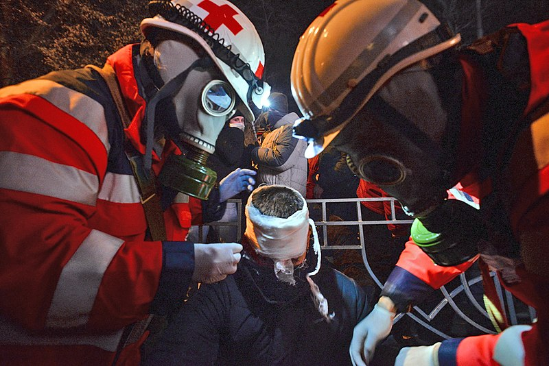 Ukrainian Red Cross Society volunteers administering first aid to a wounded protester. Euromaidan Protests. Events of Jan 19, 2014-2