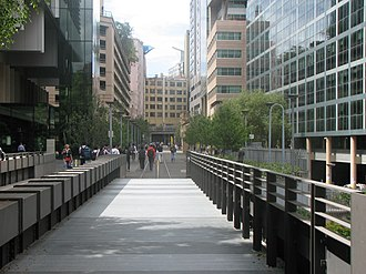 Ultimo Road railway underbridge - Pedestrians walk along the former railway line