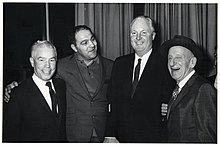 Unidentified man, boxer Rocky Marciano, Mayor John F. Collins, and singer Jimmy Durante (10559562993).jpg
