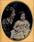 Unidentified young girl and mother (5570138315).jpg