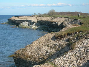 Coastal geography - Collapsed Ordovician limestone bank showing coastal erosion. NW Osmussaar, Estonia.