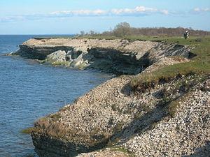 Coastal geography - Collapsed Ordovician limestone bank showing coastal erosion. NW Osmussaar, Estonia.