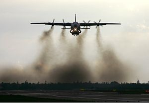 Antonov An-12 - An An-12A of Vega Air makes a traditional smokey takeoff from Kastrup Airport (2004).