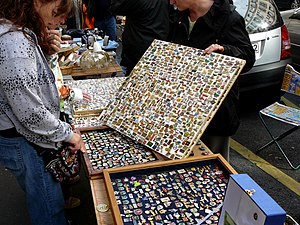 Lapel pin - A lapel pin vendor in Paris