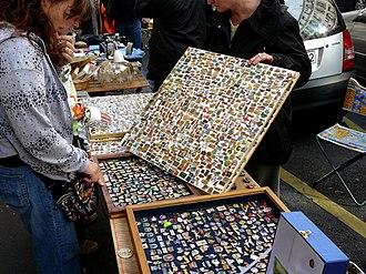 Lapel pin - A lapel pin vendor in Paris