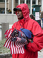 Vendor in red jacket with flags Inauguration 2013.jpg