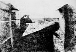 Nicéphore Niépce's earliest surviving photograph, c. 1826. This image required an eight-hour exposure, which resulted in sunlight being visible on both sides of the buildings.