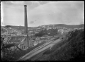 View of the old gas works and Caversham Railway Station, Dunedin ATLIB 294044.png