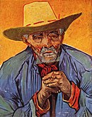 A closeup portrait of an elderly man with a moustache and beard facing to his left (the viewer's right). He has an intense, thoughtful look on his face and his hands are both clutching his cane in front of him; he is wearing a large yellow hat, in front of a vivid orange background.
