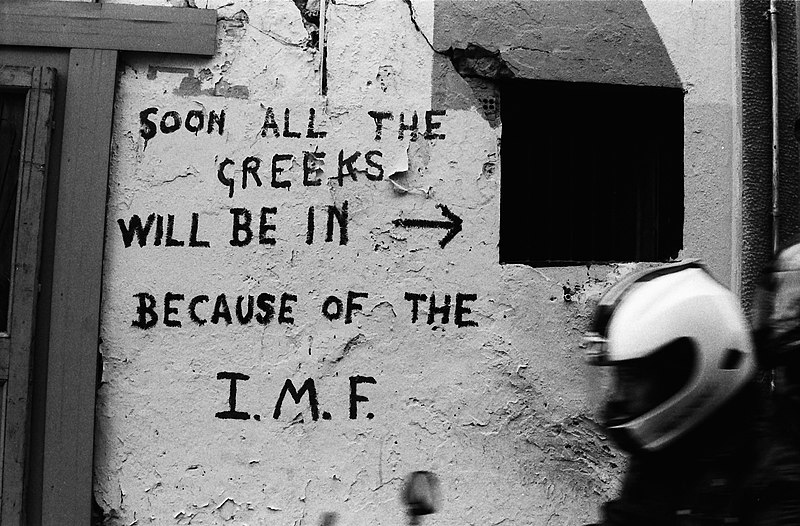 File:Wall writing against IMF in Greece.jpg