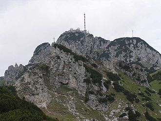 Wendelstein (mountain) - The Wendelstein from the southeast. Foreground: the Kesselwand and summit cross. Between the Kesselwand and the Wendelstein is the Reindler-Kessel at about 1600 m, through which the railway runs. The Kesselwand and Wendelstein are not a single massif