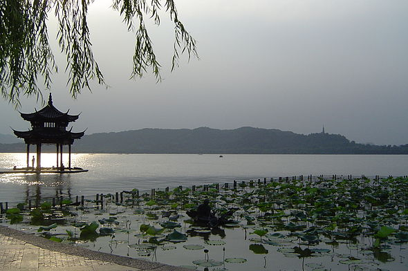 A section of the West Lake with the pavilion on the left that is said to mark the spot of an archery range in the Wuyue period. West Lake.JPG