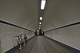 West end of the Sint-Annatunnel with two bicycles in Antwerp, Belgium (DSCF3975).jpg