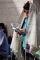 Woman praying with tallit.jpg