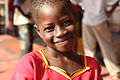 Young girl smiles after arriving in Juba, Sudan.jpg