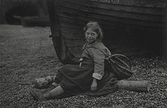 'At Auchmithie 1881'. Girl with basket sitting on shore in front of boat.jpg