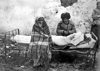 Deportation of the Chechens and Ingush - An Ingush family mourning the death of their daughter in Kazakhstan