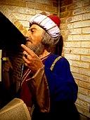 تندیس علامه جلال الدین دوانی کازرونی در موزه تاریخ پارس.jpg