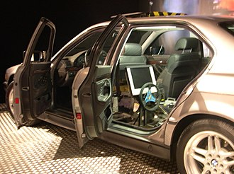 Tomorrow Never Dies - A modified BMW 7 Series car with a steering wheel on the back seat, seen at an exhibition at Museum Industriekultur, Nuremberg.