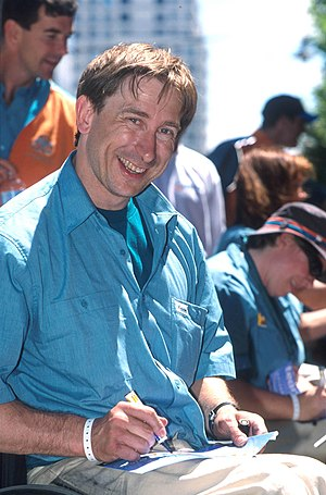 Sandy Blythe - Blythe smiling as he autographs a fan's item at the Welcome Home Parade after the 2000 Summer Paralympics
