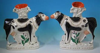 Staffordshire figures - Image: 1850 Milk Sold Here Cow spill vases, enamels and gilt over lead glaze