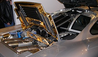 McLaren F1 - The McLaren F1's engine compartment contains the mid-mounted BMW S70/2 engine and uses gold foil as a heat shield in the exhaust compartment