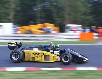 Minardi - 1985 vintage Minardi M185 driven by Roderigo Gallego at a Thoroughbred Grand Prix event at Brands Hatch in September 2005