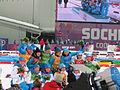 2014 WOG Biathlon Women Relay Flower Ceremony 04.JPG