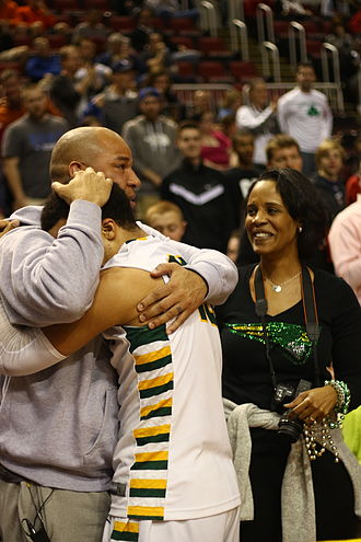 Rick Brunson - Brunson embraces son Jalen as Sandra Brunson looks on after winning the 2015 IHSA Class 4A championship.