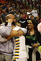 20150321 IHSA Class 4A championship game Rick Brunson embraces Jalen as Sandra Brunson looks on.JPG