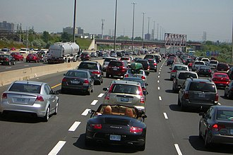 Pickering, Ontario - Traffic congestion on Highway 401 in Pickering. During rush hours and special holidays, Highway 401 suffers severe traffic jams, as several lanes end at Salem Road in Ajax causing a traffic bottleneck.