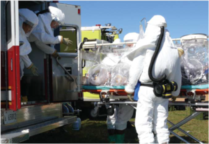 Aeromedical Isolation Team - The AIT conducting training in PPE while transporting a mock patient in an ATI at Fort Detrick. (Photo by Bruce Maston, 2007)