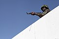 A Gambian soldier participating in exercise Western Accord 2012 practices clearing a rooftop during urban combat techniques training July 13, 2012, in Thies, Senegal 120713-M-ZR240-015.jpg