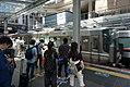 A JR train arriving in station.jpg