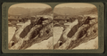 A Mountain of 'Petrified Water'- Pulpit Terrace and Mammoth Spring Hotel, Yellowstone Park, U.S.A, by Underwood & Underwood 2.png