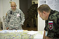 A U.S. Army noncommissioned officer, left, assigned to the Joint Multinational Readiness Center in Hohenfels, Germany, reviews a map with a Slovenian soldier during exercise Immediate Response 2013 in Zagreb 130825-A-WB953-185.jpg
