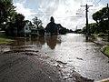 A flooded street in Brassall, Ipswich.jpg
