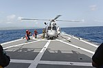 A helicopter prepares to lift off from the flightdeck of the ARM Guanajuato - 160625-N-FE728-151.jpg