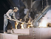A large electric phosphate smelting furnace used to make elemental phosphorus in a TVA chemical plant in the vicinity of Muscle Shoals, Ala.jpg