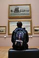 A man contemplating the artworks in a room of the Palais des Beaux-Arts de Lille.jpg